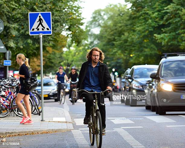 Cool man with skateboard, on bike