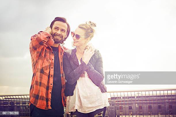 cool mid adult couple on rooftop parking lot - mid adult couple stock pictures, royalty-free photos & images