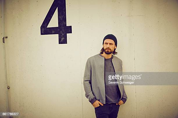 Cool mid adult man leaning against wall number four