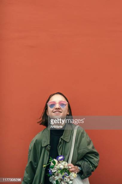 cool modern teenage girl wearing heart shape sunglasses on valentine day - valentine' day stock pictures, royalty-free photos & images