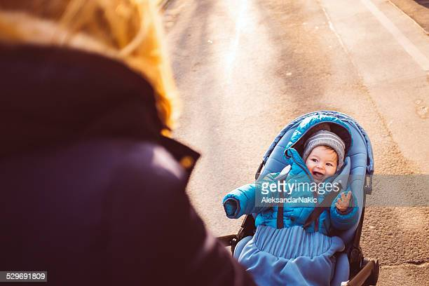 Cool mom pushing buggy outdoors