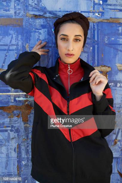Cool muslim woman against blue background