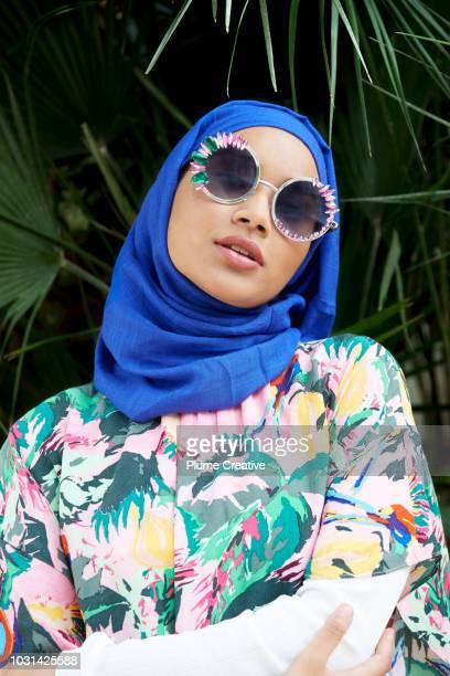 Cool muslim woman in big sunglasses