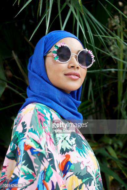 Cool muslim woman in over-sized sunglasses