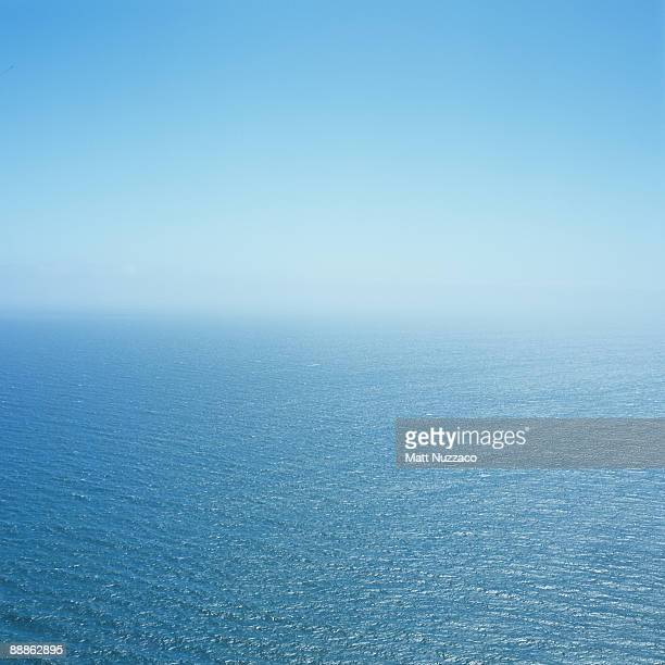cool ocean breeze - horizon over water stock pictures, royalty-free photos & images