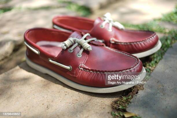 cool red sperry amareto leather shoes - brown shoe stock pictures, royalty-free photos & images