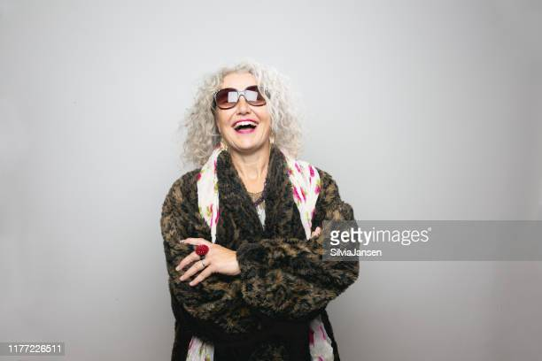 cool senior woman with sunglasses - cool attitude stock pictures, royalty-free photos & images