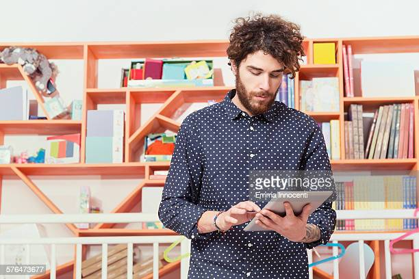 cool shop owner checking stock with tablet