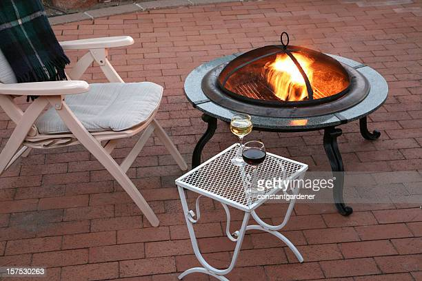 cool summer evening on the patio - fire pit stock pictures, royalty-free photos & images