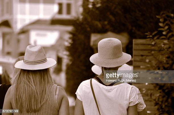 cool, summer hats toned photograph - mesh shirt stock photos and pictures