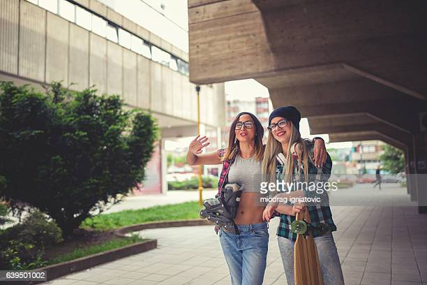 Cool teenage longboarders smiling and talking