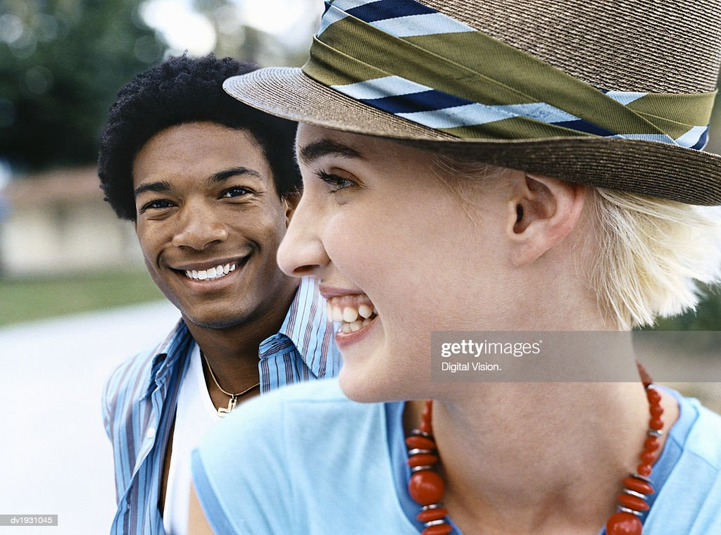 Cool Twentysomething Man and Woman, Close-up of Woman Wearing a Trilby Hat : Stock Photo