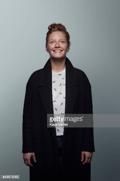 cool woman smiling to camera - overcoat stock pictures, royalty-free photos & images