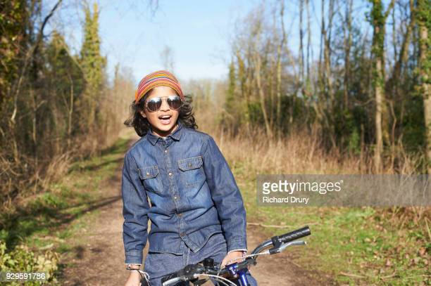 Cool young boy on cycle track