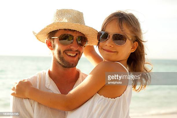 cool young dad with daughter on the beach