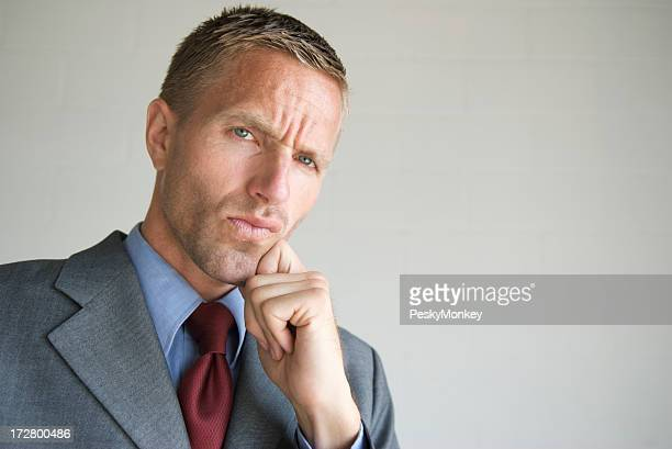 Cool Young Man Businessman Thinking with Hand on Chin