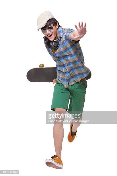 cool young man with skateboard - fast fashion stock pictures, royalty-free photos & images