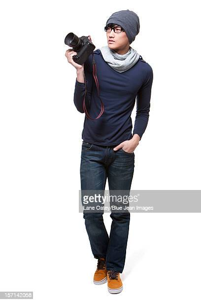 Cool young photographer with camera