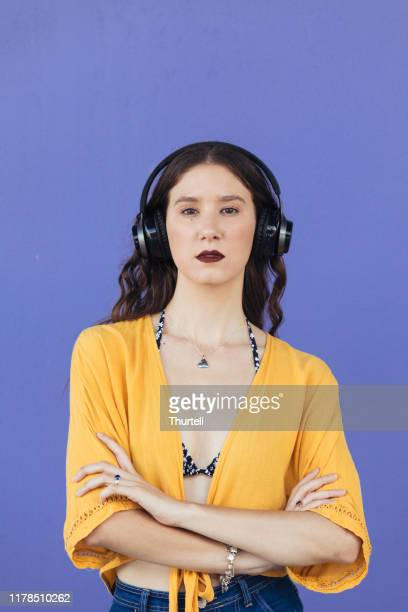 cool young woman listening to music - publicity event stock pictures, royalty-free photos & images