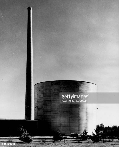 Cooling air for the reactor's graphite reflector is forced out of the 150ft stack at the Medical research reactor building at Brookhaven New York...