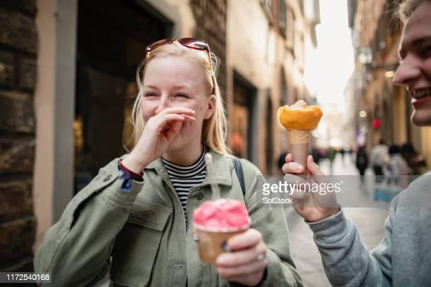 cooling down with ice cream - gelato italiano foto e immagini stock