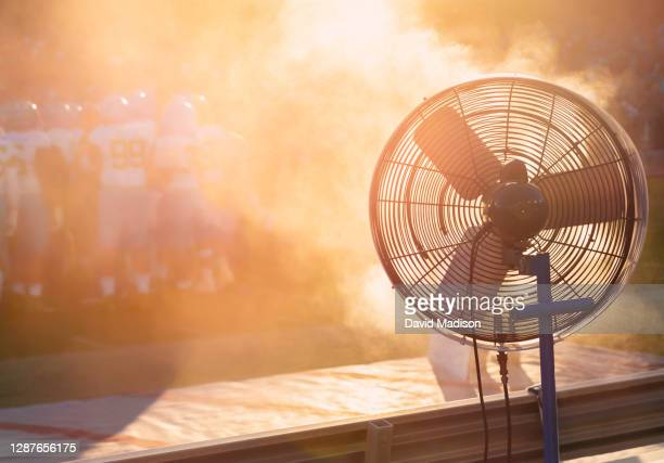 cooling fan on sidelines of football game - humid stock pictures, royalty-free photos & images
