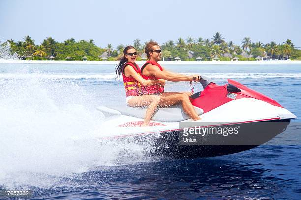 cooling off in the tropics - jet ski stock pictures, royalty-free photos & images