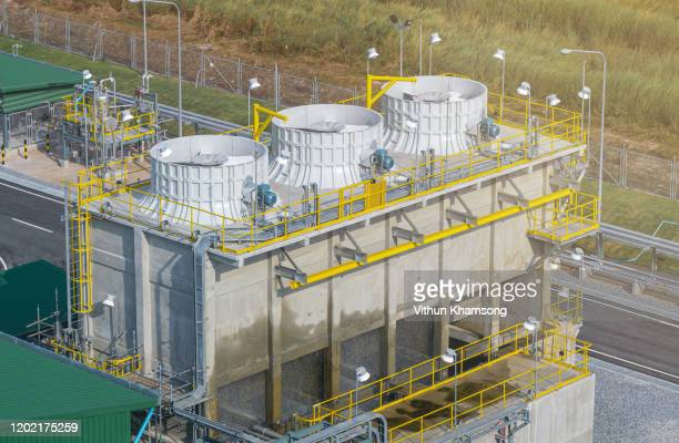 cooling tower at factory - cooling tower stock pictures, royalty-free photos & images