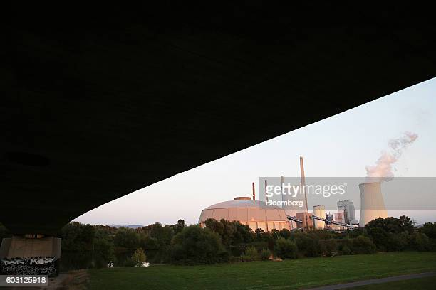 A cooling tower emits vapour at the coalpowered power plant operated by Uniper SE in Grosskrotzenburg Germany on Sunday Sept 11 2016 EON SE cut most...