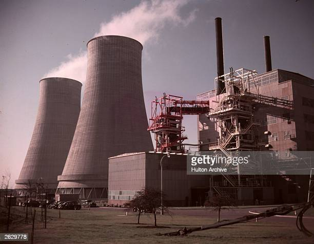 Cooling towers and a reactor at the world's first fullscale atomic power station at Calder Hall Cumberland England The station which will use atomic...