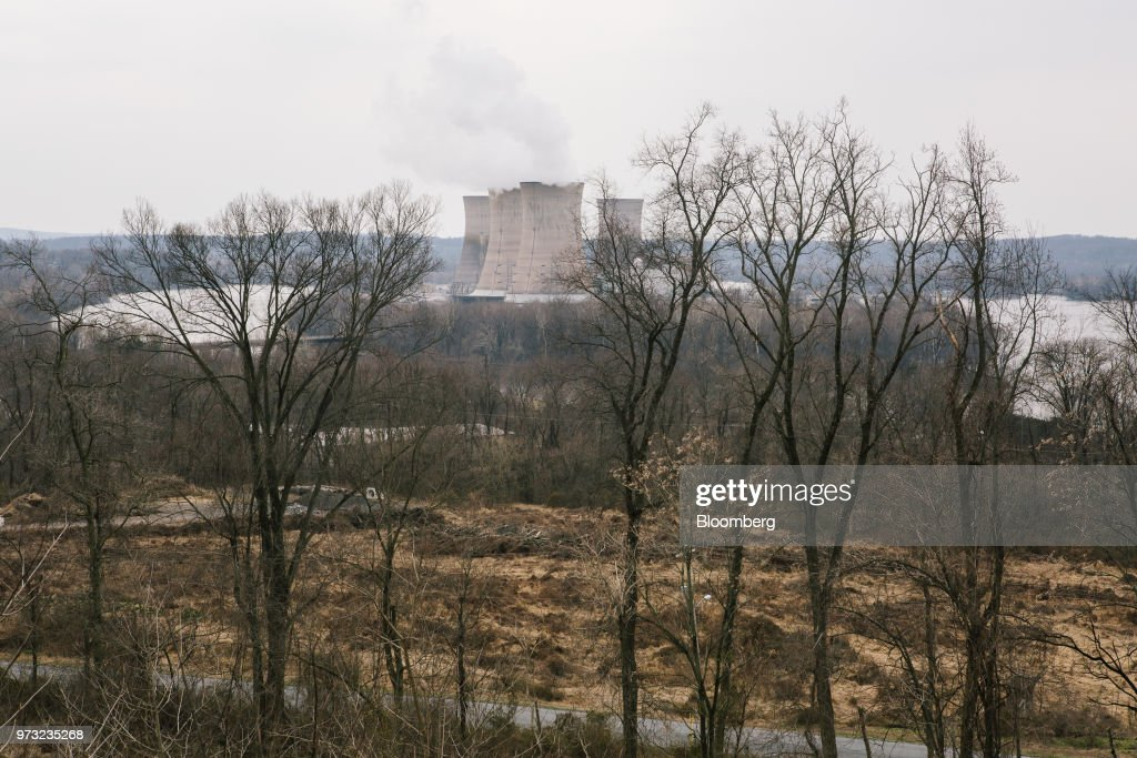 Cooling towers at the Exelon Corp. Three Mile Island nuclear power plant are seen from the neighborhood of Londonderry Township near Middletown, Pennsylvania, U.S., on Wednesday, April 11, 2018. On Sept. 30, Exelon Corp. plans to take Three Mile Island offline because it is no longer profitable. Across the U.S., Nuclear plants are having trouble staying competitive in an era of cheap natural gas, a product of the shale boom. Photographer: Michelle Gustafson/Bloomberg via Getty Images