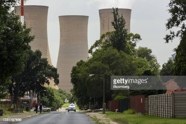 Cooling towers at the Komati coal-fired power station, operated by Eskom Holdings SOC Ltd., in Mpumalanga, South Africa, on Tuesday, Jan. 12, 2021....