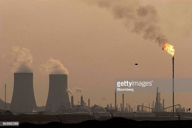Cooling towers emit steam at the Sasol Secunda plant in the eastern highlands of Mpumalanga province, South Africa, on Sunday, Sept. 9, 2007. Sasol...