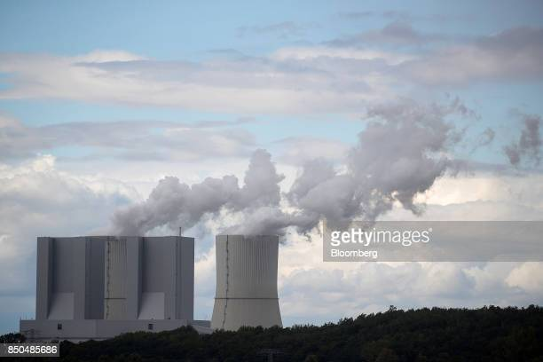 Cooling towers emit vapor at Lippendorf lignitefired power plant operated by Vatenfall AB near the village of Poedelwitz Germany on Wednesday Sept 6...