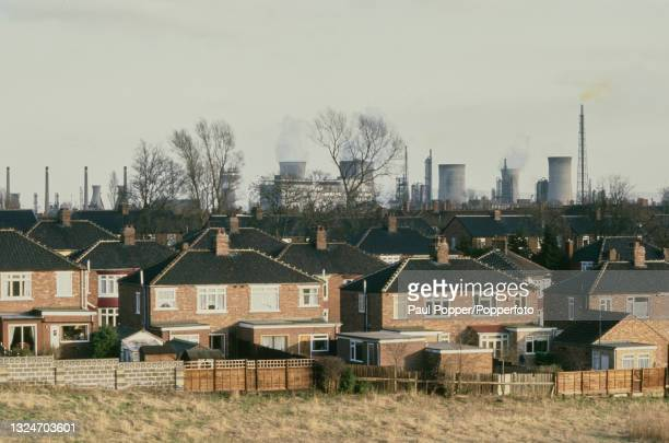 Cooling towers of the Billingham Manufacturing Plant, a large chemical works, rise up behind semi detached houses on a housing estate at Billingham...