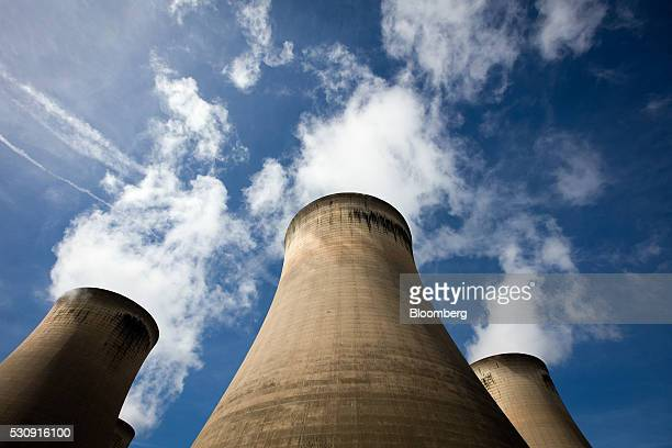 Cooling towers stand within the Drax Group Plc's power station complex near Selby UK on Wednesday May 4 2016 Drax Group Plc the utility converting...