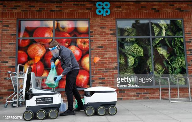 Co-op supermarket worker loads a Starship delivery robot with groceries during a visit from the Labour Leader Keir Starmer on July 23, 2020 in Milton...