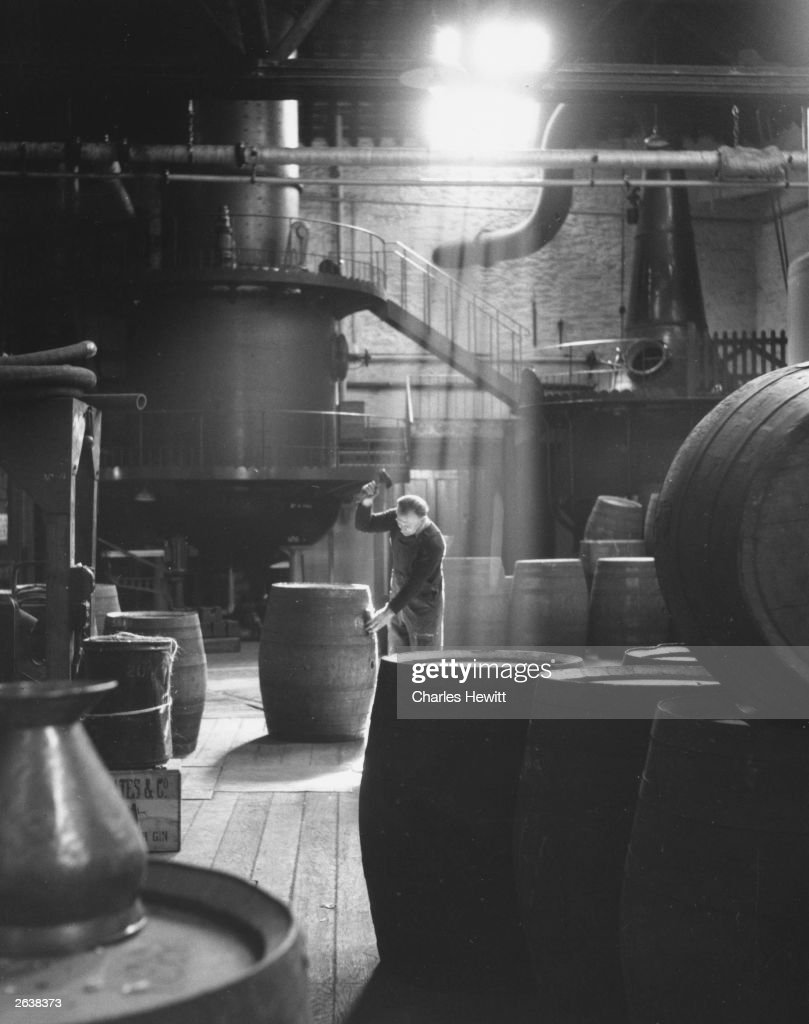 A cooper at work making barrels in Coates Gin Distillery, Plymouth. Original Publication: Picture Post - 7161 - The Best and Worst of British Cities 4 - Plymouth - pub. 1954