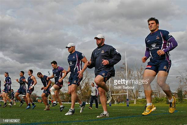Cooper Cronk and Billy Slater of the Storm perform training exercises during a Melbourne Storm NRL training session at Gosch's Paddock on July 24...