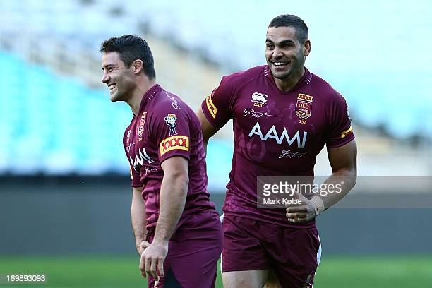 Cooper Cronk and Greg Inglis smile during a Queensland Maroons state of origin training session at ANZ Stadium on June 4 2013 in Sydney Australia