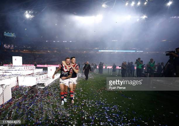 Cooper Cronk and Jake Friend of the Roosters celebrate victory after the 2019 NRL Grand Final match between the Canberra Raiders and the Sydney...