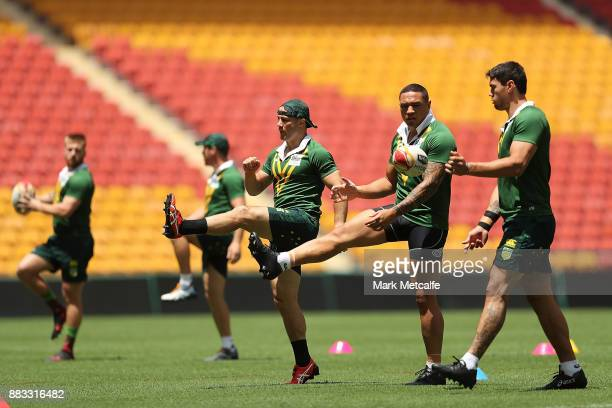 Cooper Cronk and Tyson Frizell of Australia stretch during an Australian Kangaroos training session at Suncorp Stadium on December 1 2017 in Brisbane...