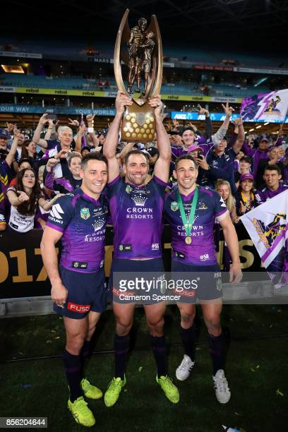 Cooper Cronk Cameron Smith and Billy Slater of the Storm pose with the ProvanSummons Trophy after winning the 2017 NRL Grand Final match between the...