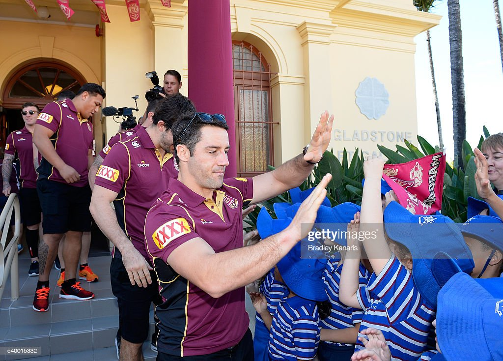 Cooper Cronk high fives young fans during a Queensland Maroons State of Origin Fan Day on June 14, 2016 in Gladstone, Australia.