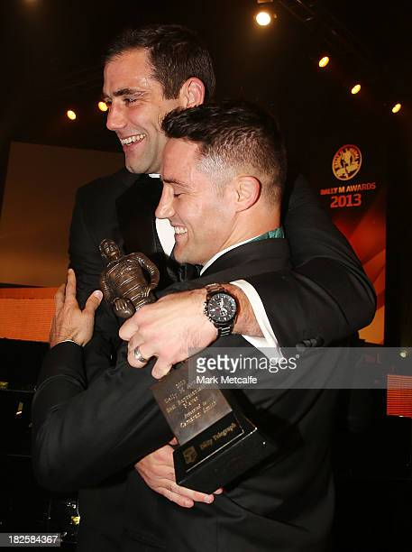 Cooper Cronk is congratulated by Cameron Smith after winning the Dally M Medal during the 2013 Dally M Awards at Star City on October 1 2013 in...