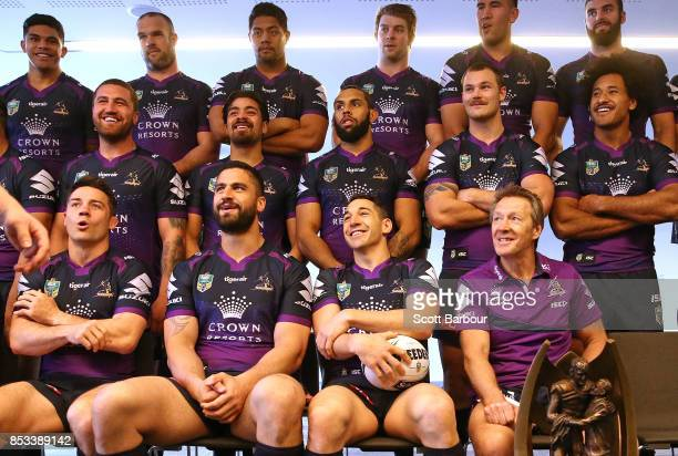 Cooper Cronk Jesse Bromwich Billy Slater and coach Craig Bellamy look on as they pose for their team photo with the ProvanSummons trophy during a...