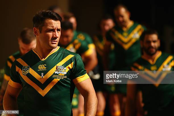 Cooper Cronk looks on as he arrives with his team mates for the Australia Kangaroos Test team photo session at Crowne Plaza Coogee on May 2 2016 in...