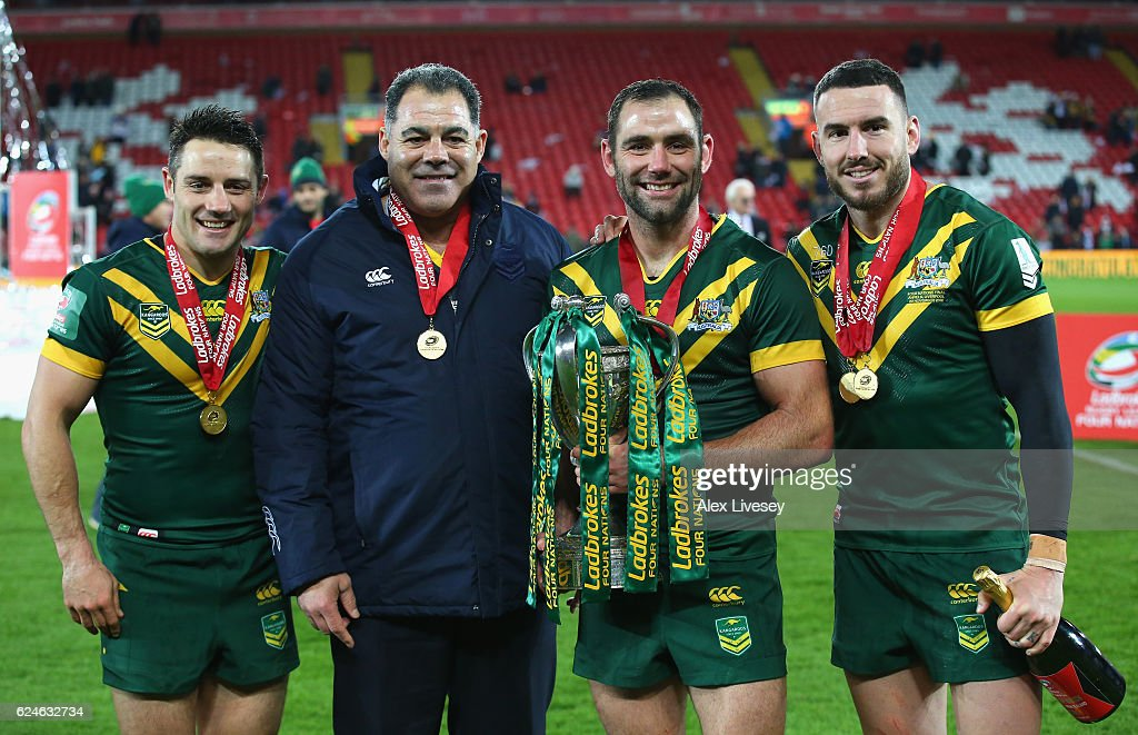 Cooper Cronk, Mal Meninga, Coach of Australia, Cameron Smith and Darius Boyd of Australia celebrate with the trophy after victory in the Four Nations Final between New Zealand and Australia at Anfield on November 20, 2016 in Liverpool, United Kingdom.