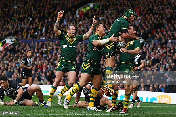Cooper Cronk of Australia celebrates scoring his sides second try with Johnathan ThurstonJosh Papalii and Darius Boyd during the Rugby League World...