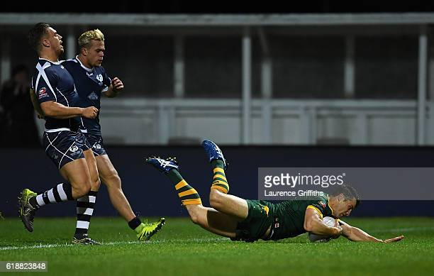 Cooper Cronk of Australia dives over to score his second try during the Four Nations match between the Australian Kangaroos and Scotland at KCOM...